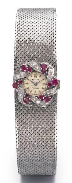 ROLEX A FINE LADY'S WHITE GOLD, DIAMOND AND RUBY-SET BRACELET WATCH CIRCA 1950
