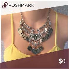 """Gypsy Vintage Bib Style Coin Pendant Necklace New Gypsy Vintage Coin Bib Style Necklace. Antique like Silver Festive Coin. Very well made with a 6""""Drop it has a Lobster Style Clasp. You can adjust as small as you like. Please see my other items. Bundle 3 or more and receive a 15% discount. Thank you for browsing my closet. Boutique Jewelry"""