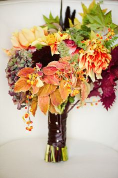 Unique, beautiful fall bouquet mixing flowers with the changing leaves. Money saver and beauty amplifier! #winning