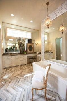 chevron tile marble bathroom floor... a little too glam for my taste, but that floor is totally GORG in that gray-white chevron pattern!
