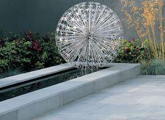 allium sculpture set above a rill - Stonemarket: Garden range: Natural Stone: Avant-Garde Paving