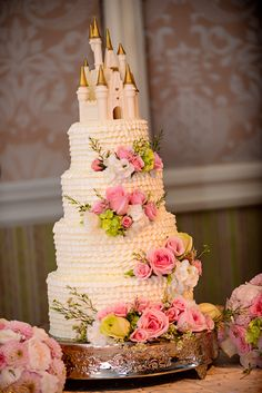 Four tiers of magnificent frosting combined to create a cake worthy of just about any princess bride