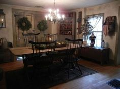 Early New England.....I love the wreaths on the doors!! I would love this primitive look on all my interior doors!!