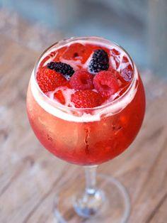 Jingle Jangle Punch- Berry vodka, fresh berries, lemon juice, champagne..this looks delicious! Christmas brunch beverage.