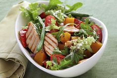Mixed greens, sliced pear tomatos, grilled chicken, grilled red bell pepper, grilled mango chunks, green beans, and red onions