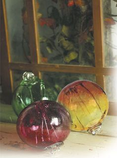 Historically sound, these hand-blown globes were believed to absorb evil spells, and frequented the homes in colonial New England during the witch hunts. Gnarled spikes within the beautiful art glass ornamentals were attributed for the security because witches were supposedly attracted to such things. Each is a unique original. Includes history card. 7in