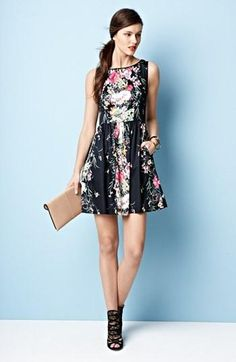 Feminine, yet edgy floral fit & flare dress.