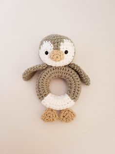 This is a DOWNLOADABLE PDF pattern with all the instructions you need to create an adorable playful penguin rattle. This rattle / teether makes a gorgeous baby shower gift!