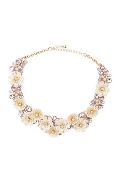 A high polish statement necklace featuring flowers made out of sequin and faux gems, and a lobster clasp closure.