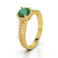 #Anillo con oro amarillo esmeralda y #diamante