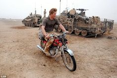 Prince Harry rides an abandoned motorcycle past his Spartan armoured vehicle, in the desert in Helmand province in Southern Afghanistan, where he was based in 2008. Author MG Harris believes he was the inspiration behind the lead character in her new series of children's adventure novels