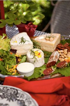 Pretty cheese tray! Love the use of herbs on top of the cheese for decor!
