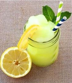 This easy Frozen Lemonade Slush is the perfect way to cool off on a hot day! This easy Frozen Lemonade Slush is the perfect way to cool off on a hot day! Green Punch Recipes, Slush Recipes, Frozen Drink Recipes, Party Punch Recipes, Frozen Drinks, Coctails Recipes, Frozen Lemonade Recipes, Lemonade Slush Recipe, Vodka Lemonade