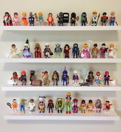 Shelves to display Playmobil figures.