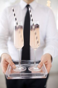 Black and white wedding? How about a matching black and white wedding champagne cocktail?