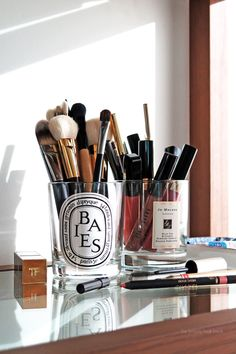Store your brushes in cleaned-out candle jars