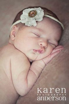 Newborn baby girl with Karen Anderson Photography.