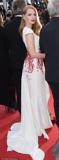 Sweeping: The Miss Sloane actress opted for a plunging white gown that teased at her cleav...