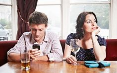 Turned off: Many of Britain's 30 million smartphone owners think nothing of checking Twitter during a conversation - The new global addiction: smartphones