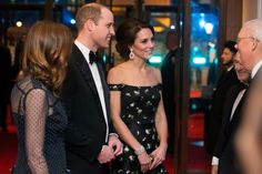 Kate Middleton Photos Photos - Britain's Prince William, Duke of Cambridge (2L) and Britain's Catherine, Duchess of Cambridge (R) meet with BAFTA representatives as they arrive to attend the BAFTA British Academy Film Awards at the Royal Albert Hall in London on February 12, 2017...The British Academy of Film and Television Arts supports, develops and promotes the art forms of the moving image by identifying and rewarding excellence, inspiring practitioners and benefiting the public. / AFP…