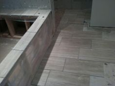 "12""X24"" tiles on the floor and tub during installation id like tiles all over like that"