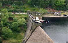 16th May 2008 - A Lancaster bomber swoops over Derwent dam in central England, to mark the 65th anniversary of the raid that destroyed German dams during World War II.