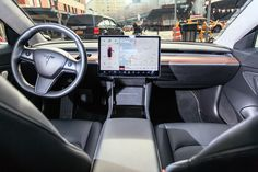 Tesla Model 3 has the most minimalist interior we've ever seen in a production car. March 2018