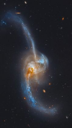 False-color HST image of peculiar spiral galaxy NGC 2623, aka Arp 243; about 260 mly away in Cancer & 180,000 ly across. The core of the galaxy, filled w/exceptionally large numbers of bright young stars, causes it to be classified as a Seyfert galaxy (type Sy 2)