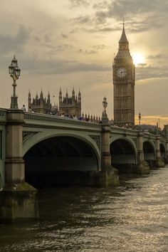 Here's a beautiful view of the bridge leading toward Big Ben, next to the...