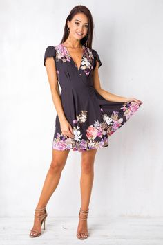 """The """"Milly wrap dress"""" is the perfect day dress for summer! Featuring a simple wrap style, cap sleeve, cute print and flared skirt. Wear lace up flats and a wide brimmed hat for a cute festival outfit! Size 8, Length:89cm/35inches Width:35cm/14inches Cotton/Polyester Cold Hand Wash Only Model wears a size 6 Model's height 170cm  Prints may vary Imported A slight variation may occur in colours and size specifications. Colours may appear slightly different via we..."""