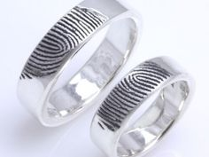 Brent & Jess Custom Handmade Fingerprint Wedding Rings and Jewelry-- They have some other designs I love. Such a cute idea!