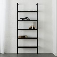 "Shop Stairway Black 72. 5"" Wall Mounted Bookcase.   Minimalism scales for small spaces in neutral black.  A shorter version of a CB2 favorite, five shelves ladder up in engineered wood with glossy lacquer."