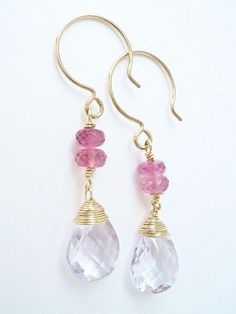 Raspberry pink and the palest lavender create a pink lover's dream pair of earrings. AAA pink amethyst pear briolettes with exceptionally fine faceting dangle beneath AA pink tourmaline faceted rondelles. Pink gemstones aren't particularly common and I love this combination. The pink amethysts have just a whisper of lavender/pink which is enhanced by the saturated hue of the pink tourmaline - very pretty and feminine! Linda's Handcrafted Design GEMSTONES - AAA Pink Amethyst Faceted Pears…