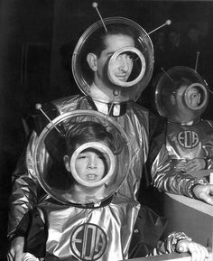 Black & White Man and two boys in 1950s space garb