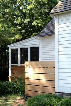 Modern Fence built to hide the Mechanicals on the outside of the house, by Erik Block Design-Build