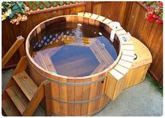 """Japanese-Style-Outdoor-Cedar-Hot-Tub via http://newsdesigninterior.com/japanese-style-outdoor-cedar-hot-tubs/."" I think it would be possible for us to build one of these ourselves. -CAB"