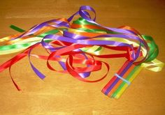 Make your own rhythm ribbons with craft sticks, ribbon, and glue!
