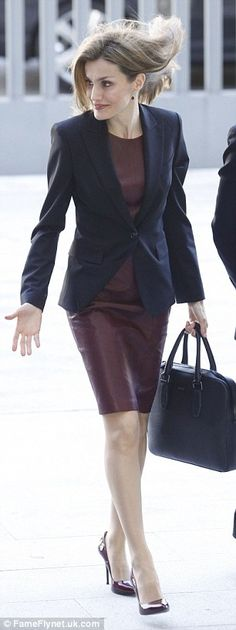 All business: She kept the dress businesslike by adding a tailored jacket and a pair of ma...