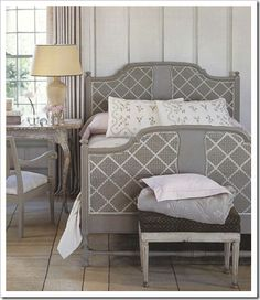 Caned Bed: Marth - Embellish a caned piece of furniture with a painted geometric design. In one step, you have added color and depth to a room. Get the look with Martha Stewart Living Paint Color in Driftwood Gray (bed) and Tailor's Chalk (accent white)