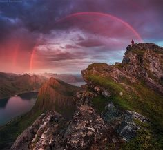 """Awesome """"red"""" sunset rainbow at Senja island, Husfjellet top. The very last ray of setting sun created a one-color rainbow.  DanielKordan.com  #Norway #Senja #Husfjellet"""