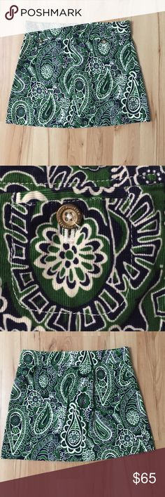 Lily Pulitzer Paisley Skirt Soft ribbed material. Green paisley design. Size 2. Waist 15in. Hip 18in. Length 15in. Two small pockets in front with gold button closure. Lilly Pulitzer Skirts Mini