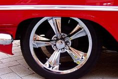 Rocket Booster Chrome Mag Wheels on a '59 Chevy