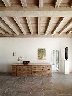 Interior by designer/antique dealer Axel Vervoordt. Love that ceiling.
