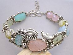A Mermaids Bangle with Dolphin, Sea horse, Lobster and Fish