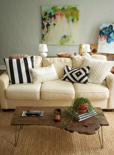 Love the couch & pillows. although a white couch with the zoo I live in would not be a great idea