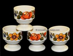 Vintage plastic Emsa egg cups with floral print, W. Germany  Set of four vintage egg cups by Emsa. Stackable. Marked at the bottom: Emsa W. Germany.   Height: 5 cm.  Diameter: 5 cm.  http://www.retro-en-design.co.uk/a-45680480/plastics/vintage-plastic-emsa-egg-cups-with-floral-print-w-germany/