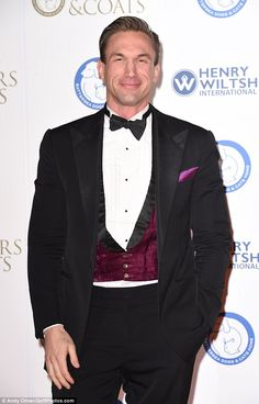 Dark and dapper: Dr Christian Jessen looked very smart in a tuxedo suit with maroon velvet...