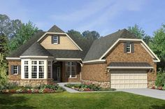 Stone and shingle accents pair beautifully with brick and a crisp white bay window. The Aberdeen plan by M/I Homes at Ivy Trails - Lifestyle. Cincinnati, OH.
