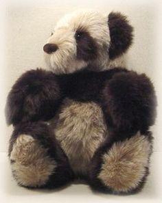 Free stuffed panda sewing pattern with a pattern similar to making a teddy bear.
