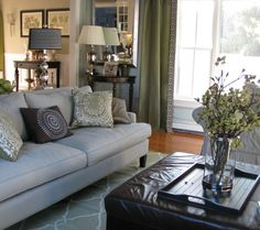 Contemporary Family Room -- Formal and Casual Mix, Contemporary/Modern blue and green living room with fabric upholstered formal furniture and green casual rug and curtains with black and white accents, Living Rooms Design